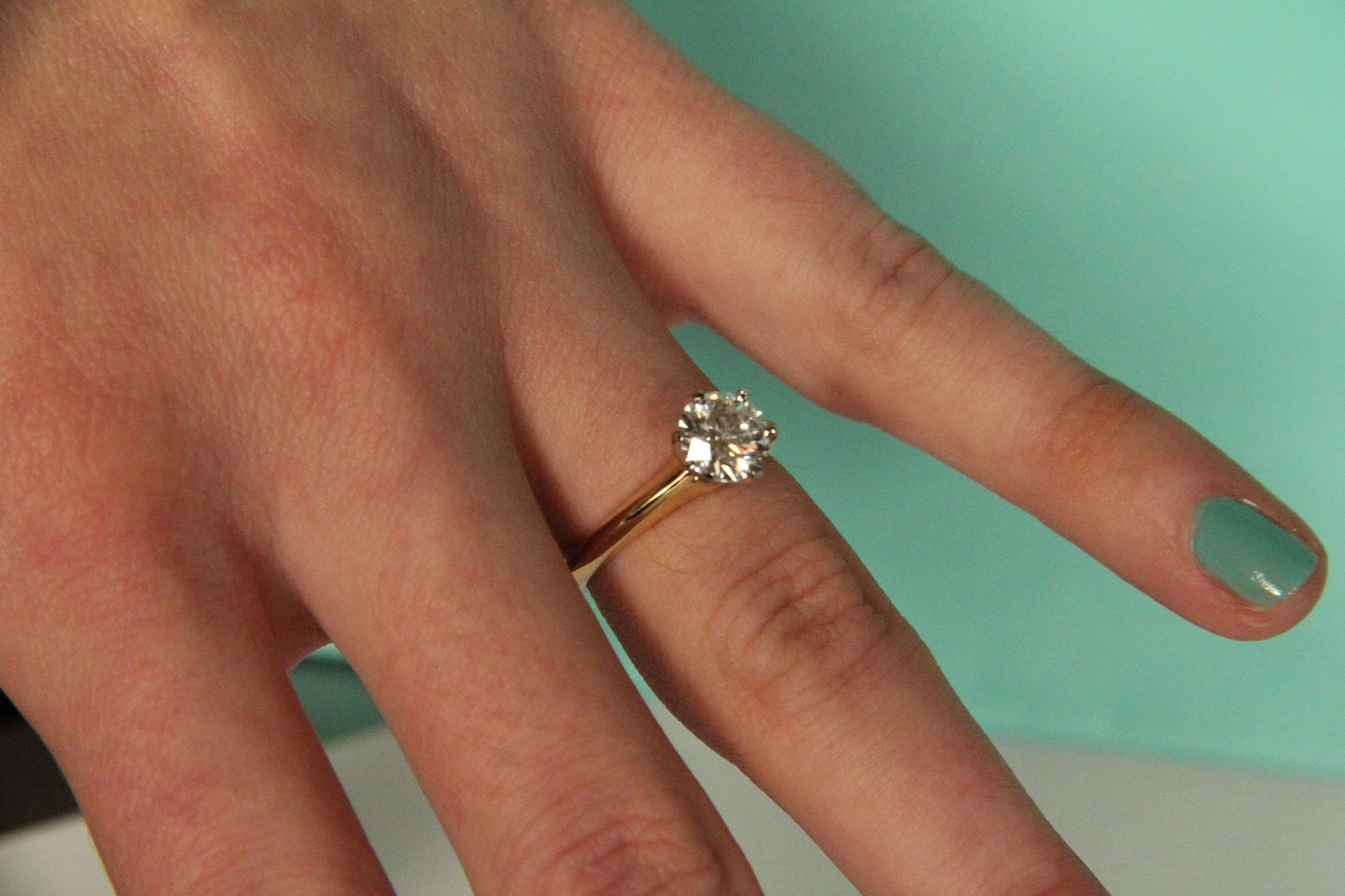 diamond engagement rings on hands